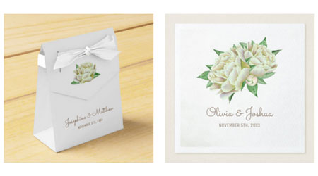 Cream peony wedding favor box with white ribbon and wedding napkins.