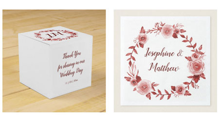 Elegant fall wedding favor boxes and wedding napkins with burgundy rose wreath design.