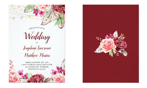 Front and back views of bohemian wedding invitations featuring a boho watercolor design with flowers, feathers, string lights on the front and burgundy background on the back.