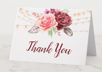 Wedding thank you note cards with bohemian watercolor design with feathers, burgundy and blush roses and string lights.
