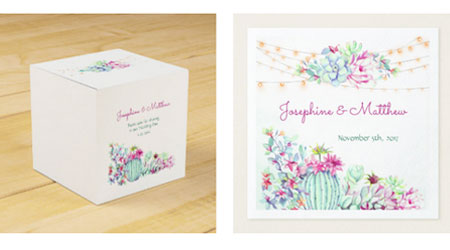 Square wedding favor boxes and wedding napkins with bride and groom names and wedding date featuring a watercolor cactus design with string lights and cactus succulent foliage and flowers.