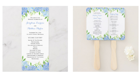 Double sided wedding ceremony programs and program hand fans featuring a watercolor blue hydrangea and greenery foliage design.