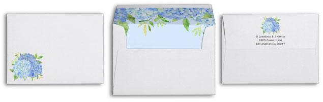Hydrangea wedding invite envelopes with blue hydrangea and greenery foliage watercolor design.