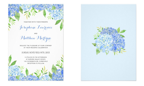 Front and back view of blue hydrangea wedding invites with greenery leaves.