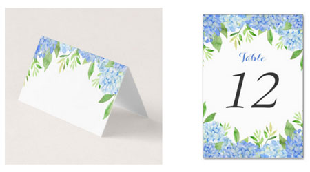 Blue hydrangea and greenery wedding place card and table number cards with watercolor floral design.
