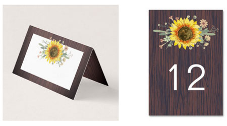 Rustic sunflower table numbers and wedding place cards with sunflowers and wood design.